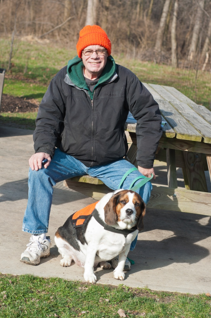 Paul, a retiree, and his dog Murphy are trail monitors for the park district. They put in a lot of volunteer hours walking the parks and helping visitors.