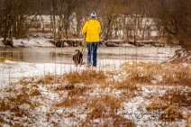 Dog walker on the river trail
